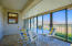 Enclosed Deck with Sliding glass doors and outdoor window shades. Tile Flooring.