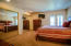 Large master bedroom, with french doors to the enclosed deck, Carpet flooring.