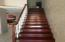 Beautiful wood stairs leading to upstairs loft - which overlooks the family room. A bedroom, bath and laundry are upstairs also.