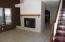 Good sized family room, with tile floors and LOTs of windows! AND wood burning fire place!