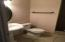 Master bathroom has pedestal sink with large, tiled, walk in shower.
