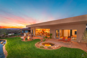 Beautiful backyard with covered patio, built-in barbecue, in-ground hot tub to enjoy the views, sunrises, and sunsets!