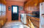 Captivating Iconic Santa Fe style home spacious laundry room and plenty of storage