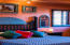 Captivating Iconic Santa Fe style home master bedroom with views of Snow Canyon