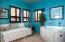 Indoor spa room off the master bedroom