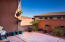 French doors opening up to this stunning pueblo revival style terrace with beautiful views.