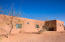 Iconic pueblo revival architecture on half acre home site with fruit trees and views that take your breath away. Perfect for low maintenance for a 2nd home or Plenty of room to add your dream pool.