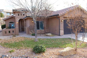 Stucco with rock work and a tile roof