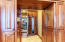 Walk-in pantry with built-in broom closet