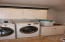 Spacious laundry room with plenty of room to hang clothes and fold!
