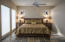 Master Suite: Slate Floors, Stained Glass Window Covers, Floor height Picture Windows with Lake Views.