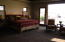 The master bedroom continues the southwest design of rustic chic.
