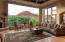 Relax in this spacious incredible space with fireplace and beautiful red mountain views