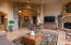 View of the living room facing the entry with a gorgeous stone arch.