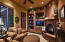 Cozy intimate sitting area with a Santa Fe style kiva fireplace with access to a private covered patio