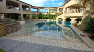 1/4 acre surface area beach entry pool