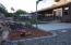 Sandbox, basketball court, patio, rose bushes, chicken coop