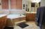 Jacuzzi bathtub, tile shower, walk-in closet
