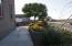 Front sidewalk, raised flower bed