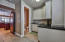 Laundry Room with Spacious Storage, Counter Space, Cabinets, Sink, Lockers and Half Bath