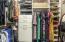 Custom cabinets in master walk in closet
