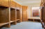 Clear Maple hardwood cabinets in mud/storage room adjacent to laundry room and garage.