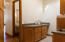 Laundry room. Concrete counter tops. clear maple cabinetry and doors, new tile flooring.
