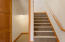 Bottom of stairway. Doorway to unique multi purpose room.