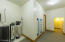 Multi purpose room. fully finished. Exercise/storage/whatever you might want. Access to two Bryant HVAC units, 75 gallon water heater and large Potassium water softener.