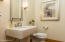 Powder bathroom with pedestal sink, new Pfister faucet and hardware.
