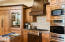 This kitchen is so well done and arranged with a wine cooler integrated into the cabinetry.