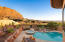 Just imagine yourself soaking in the pool or hot tub and enjoying these red rock views.... A must see home.
