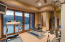 This room is being used as a fitness room but the design allows for another guest suite with wood clad sliding doors.