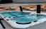 swim spa with decking and retractable hard cover