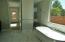 Freestanding soaking tub and two-headed walk-in shower