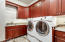 Large laundry room with tons of cabinets. Washer and dryer included in sale.