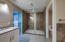 Professionally designed master bath including tile and plumbing fixtures