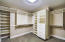Custom designed closet with clothing shoot to laundry room. How amazing is that!