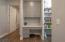 Workspace off kitchen, near kitchen pantry