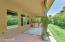 Expansive back patio has day and afternoon shade all year long.