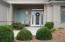 Inviting front entry with classy front door