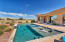 This gorgeous pool has a large shamu shelf, spa, water feature and automatic cover.