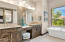 The owners' bath has ample space along with a vanity.