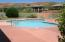 Outdoor pool ... there is also an indoor pool with hot tub