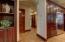 Hallway to Office, Stairs, Half Bath and Garage