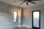Guest bedroom with views of the pine mnts and Zions, door with access to pool area