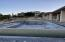 Infinity Pool with firepit and water feature bowls flowing into the pool
