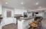 Basement entrance and kitchen