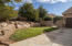 Gate to backyard off driveway