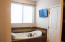 Master Tub with TV